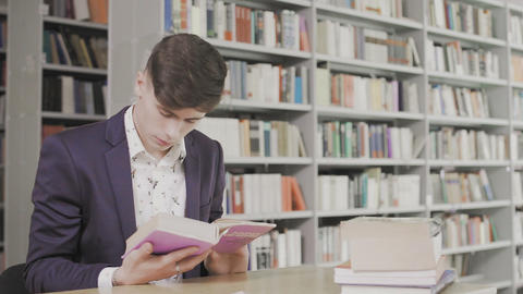 Serious Student Searching Information in Book in Library Live Action