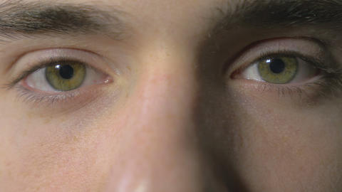 4k UHD - Close-up of a young man eyes opening and blinking Footage
