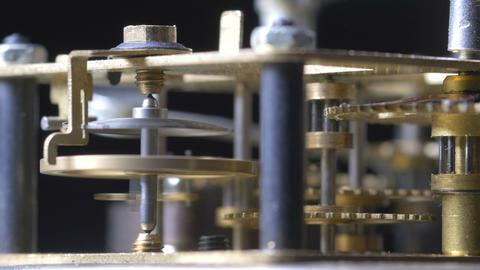 Close-up macro of a vintage clock mechanism running Footage