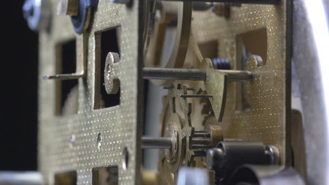 Close-up of a vintage clock mechanism running Footage
