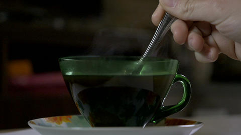 Pouring sugar in a cup of hot coffee in the morning Footage