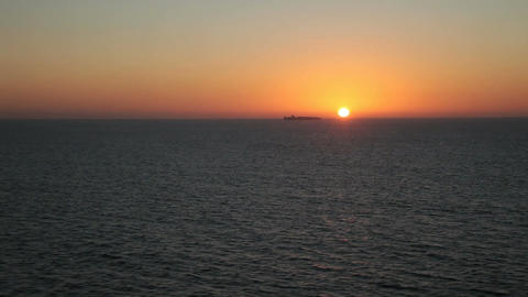 Ship on horizon sunset ocean P HD 4331 Footage