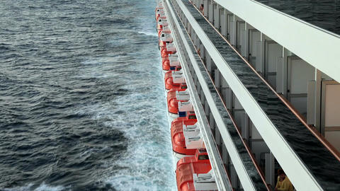 Ship starboard balconies lifeboats ocean P HD 4334 Footage