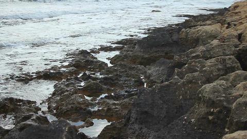 Foamy salt waves splashing on rocky seashore, shipwreck, abstract loopable shot Footage