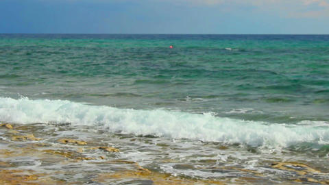 Beautiful calm seascape, blue sea waves splashing, loopable shot for meditation Footage