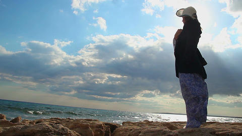 Depressed woman at seaside alone, windy cold weather, cloudy sky, sad memories Footage