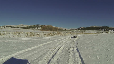 Sliding behind RZR recreation snow covered field HD 002 Live Action