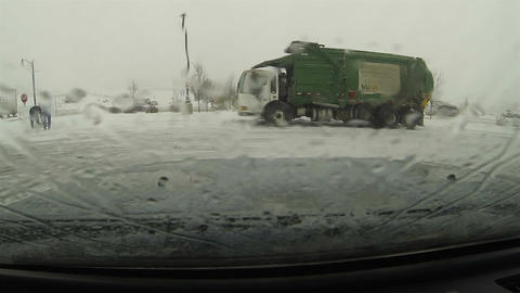 Snow storm melting on window garbage truck HD 0203 Footage