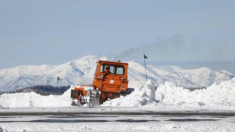 Snow plow caterpillar mountain snow P HD 6304 Footage