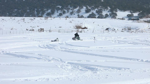 Snowmobile pulling a sled P HD 8564 Footage