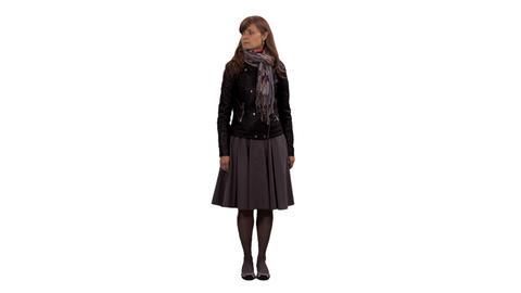 An elegant woman standing, watching something & walking away, alpha channel Footage