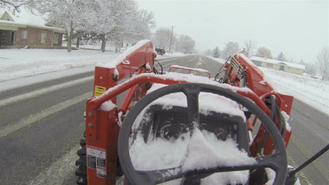 Tractor moving snow from road and driveway Point Of View HD 008 Footage