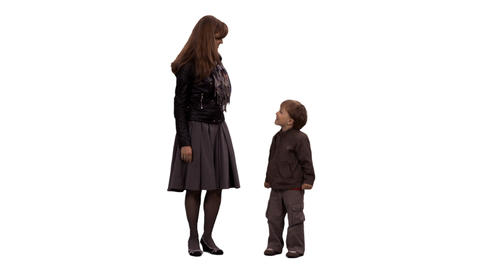 A little boy and his mother standing and talking, alpha channel Footage