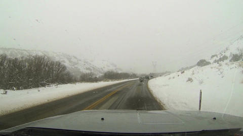Traffic on winter snow blizzard rural mountain road HD 005 Footage
