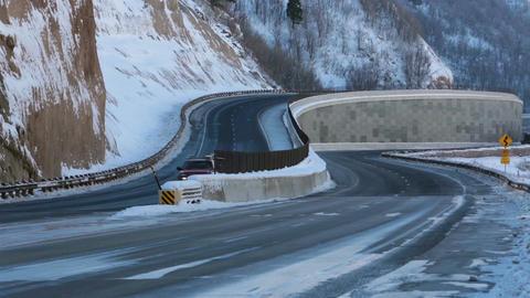 Traffic trucks cars mountain winter highway travel fast timelapse HD 0226 Footage