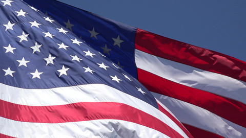 United States USA flag close blue sky background 4K Footage
