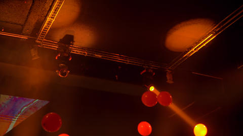 Colorful bright orange concert lighting equipment for stage at nightclub Live Action
