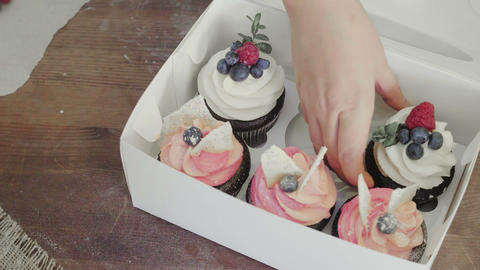 Women get homemade cakes from the box GIF