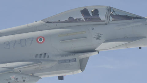 Close View of Pilot of Military Fighter Jet Aircraft in Flight Live Action