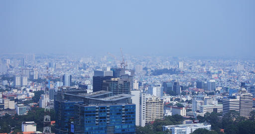 A high angle view of cityscape at the downtown in Ho Chi Minh daytime panning Live Action