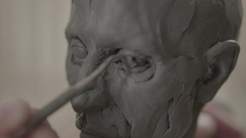 Man male sculptor is working on the creation of sculpture. Kyiv. Ukraine Live Action
