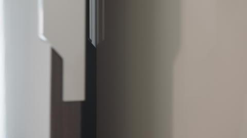 Close up of man's hand closing closet. Closing the closet door Live Action