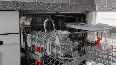 Man opens an empty dishwasher. A man's hand opens a dishwasher. Empty dishwasher Live Action