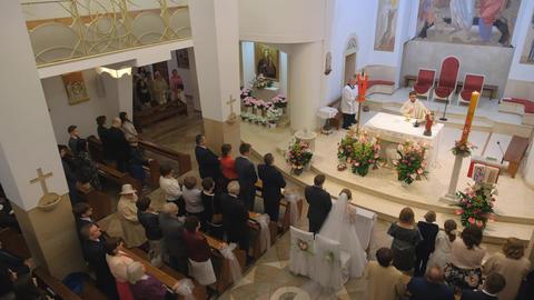 Catholic church. Church wedding ceremony. Priest is reading the prayer Live Action
