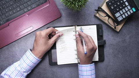 businessman open and turning page of a diary Live Action