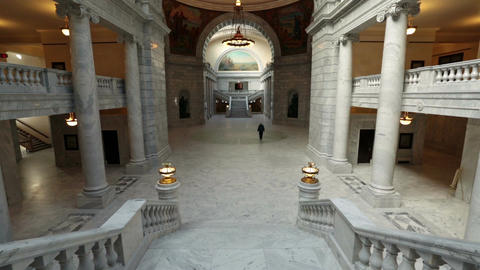 Utah State Capital man walks through rotunda building HD 4756 Footage