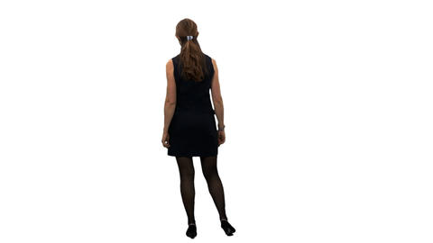 Back view of an elegant woman walking and watching something, alpha channel Live Action