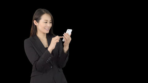 Lost young Japanese business woman using maps on iphone Footage