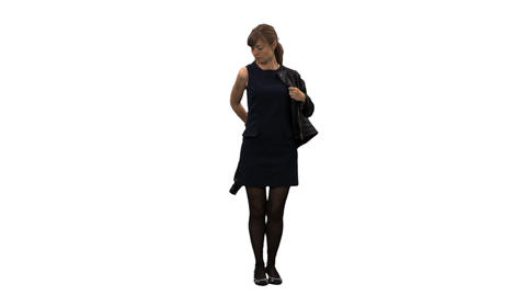 An elegant woman standing and dressing a jacket, alpha channel Footage