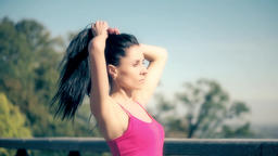 Sport woman making hair tail ponytail slow motion HD video. Preparing fitness Footage