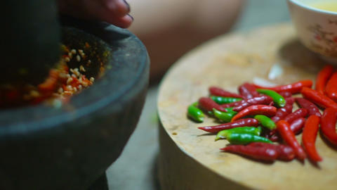 Chili pepper mixing in traditional marble mortar slowmotion Footage