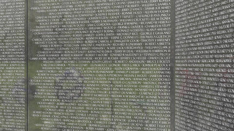 Washington DC Vietnam Veterans Memorial reflection wall names 4K 054 Footage
