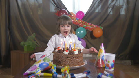 4k - Young beautiful girl blowing candles on a birthday cake Footage