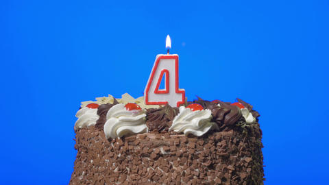 4k - Blowing out number four birthday candle on a delicious chocolate cake, blue Footage