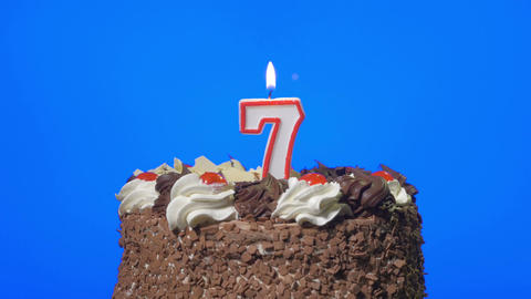4k - Blowing out number seven birthday candle on a delicious chocolate cake, blu Footage