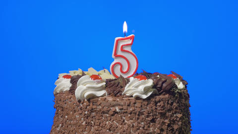 4k - Blowing out number five birthday candle on a delicious chocolate cake, blue Footage