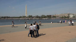 Washington DC tourists looking at monuments 4K 058 Footage