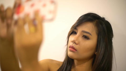 Young Thai Woman making selfie photo on smart phone Footage