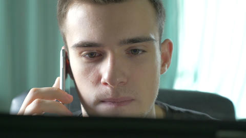 4k UHD - Young man browsing on a tablet pc and talking on the phone Footage
