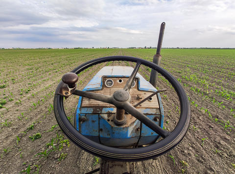 Old rusty tractor in fields 3 Photo