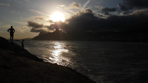 Ipanema Beach, Rio De Janeiro, Brazil. Idyllic Sunset and Silhouettes of People Live Action