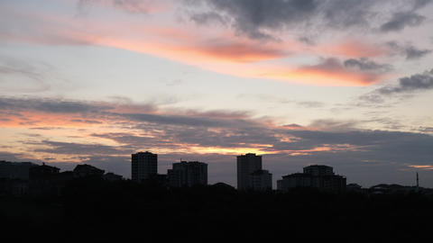 Evening clouds and buildings Live Action
