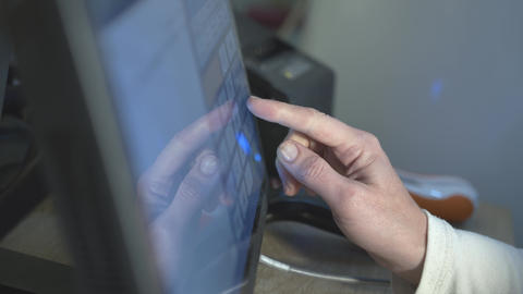 Close up of supermarket worker in protective gloves presses finger on computer Acción en vivo