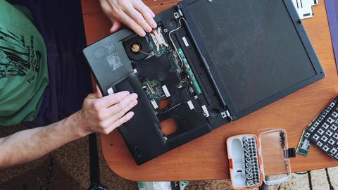 Man breaks a laptop keyboard Live Action