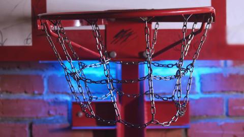 Throwing ball in the hoop with metal net and getting in the target - blue neon Acción en vivo