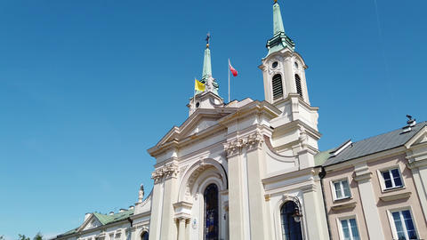 Catholic church with flags on roof Live Action